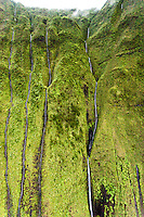 Aerial view of waterfalls flowing down cliff on Mt. Waialeale, Kauai