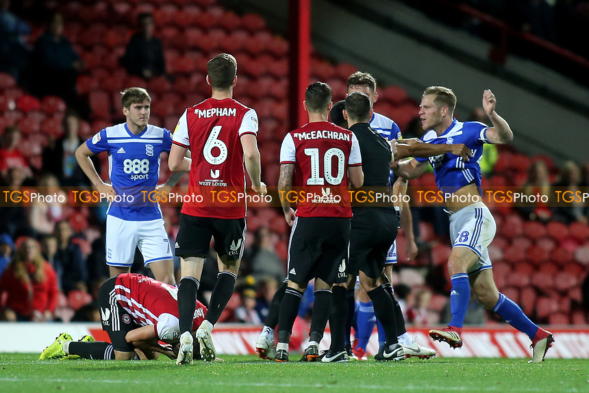 Tempers flare again in the second half as Birmingham's Michael Morrison (far right) is involved in the scuffle during Brentford vs Birmingham City, Sky Bet EFL Championship Football at Griffin Park on 2nd October 2018