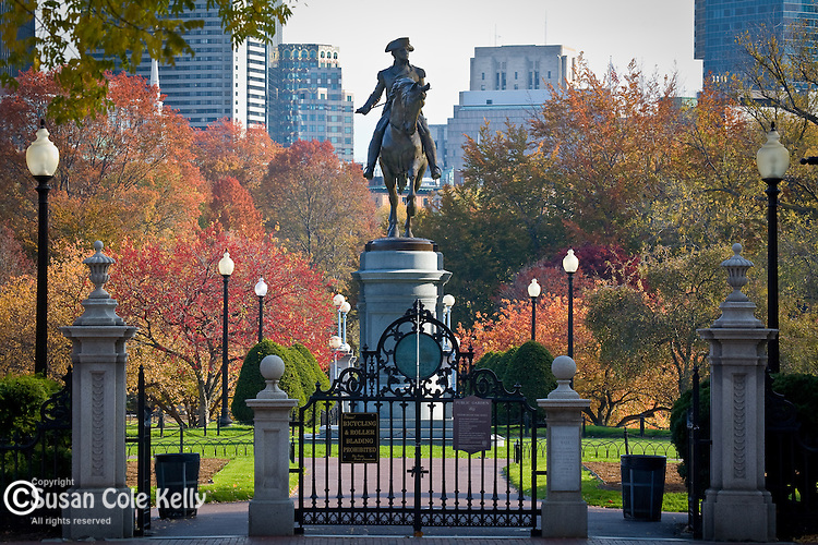 Fall foliage surrounds Thomas Ball's George Washington statue in the Boston Public Garden in Boston, MA, USA