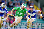 Nicky O'Sullivan and John Egan Saint Brendans in action against Paud Costello Ballyduff in the Senior county hurling Championship at Austin Stack park on Sunday.