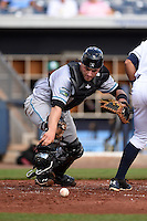 Daytona Tortugas catcher Joe Hudson (8) retrieves the ball after blocking a pitch in the dirt during a game against the Charlotte Stone Crabs on April 14, 2015 at Charlotte Sports Park in Port Charlotte, Florida.  Charlotte defeated Daytona 2-0.  (Mike Janes/Four Seam Images)