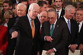 U.S. Senate Majority Whip John Cornyn and Senate Minority Leader Chuck Schumer talk while Senator Orrin Hatch (L-Rear) looks on as they attend ceremonies for the late former U.S. President George H.W. Bush inside the U.S. Capitol rotunda in Washington, D.C., U.S., December 3, 2018. REUTERS/Jonathan Ernst/Pool