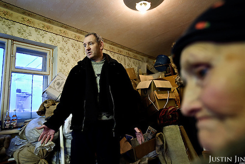 Nina Merzlikina, 75, and Sergei Kostenko, 45, have packed up their belongings at this apartment in Vorkuta, waiting to be evicted. Local officials want to close the village on the city outskirts, so they can shut off supplies of gas and electricity.<br /> <br /> Vorkuta is a coal mining and former Gulag town 1,200 miles north east of Moscow, beyond the Arctic Circle, where temperatures in winter drop to -50C. <br /> Here, whole villages are being slowly deserted and reclaimed by snow, while the financial crisis is squeezing coal mining companies that already struggle to find workers.