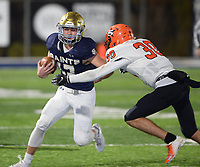 NWA Democrat-Gazette/ANDY SHUPE<br /> Shiloh Christian running back Cam Wiedemann (left) fends off Nashville defender Ty Basiliere Friday, Nov. 29, 2019, during the first half of play at Champions Stadium in Springdale. Visit nwadg.com/photos to see more photographs from the game.