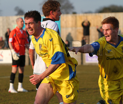 20/03/2010. Barrow forward Gregg Blundell runs off in celebration after scoring the game's only goal - teammate Jason Walker chases after him as Salisbury goalkeeper James Bittner (Orange jersey) is left stranded in the background. FA Trophy Semi Final First Leg - Salisbury City v AFC Barrow Town at Salisbury, Wiltshire, England, UK.
