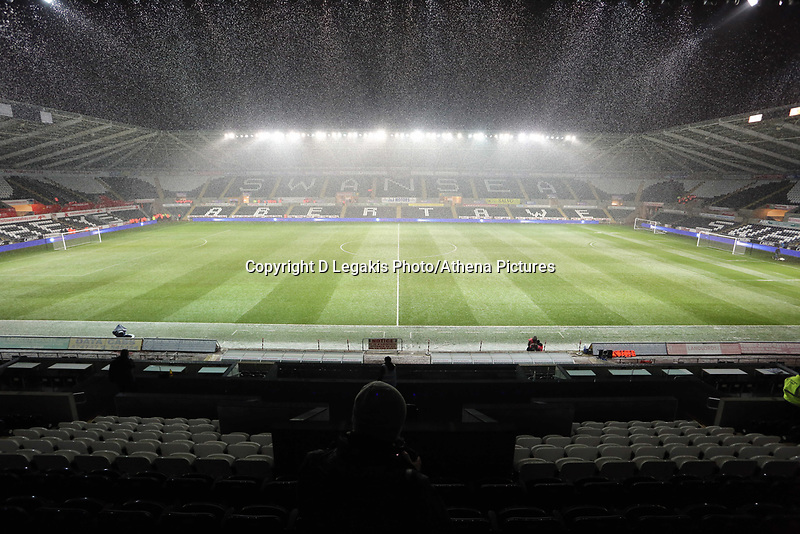 Wednesday 23 January 2013<br /> Pictured: Snow falling in the Liberty Stadium.<br /> Re: Capital One Cup semi-final second leg, Swansea City FC v Chelsea at the Liberty Stadium, south Wales.