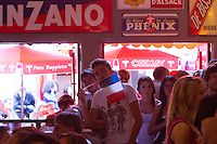 San Francisco, CA - Friday, June 20, 2014:  French soccer fan Remi Godet of France (center with flag) watches the France vs. Switzerland first round World Cup match at Cafe Bastille in San Francisco, CA.