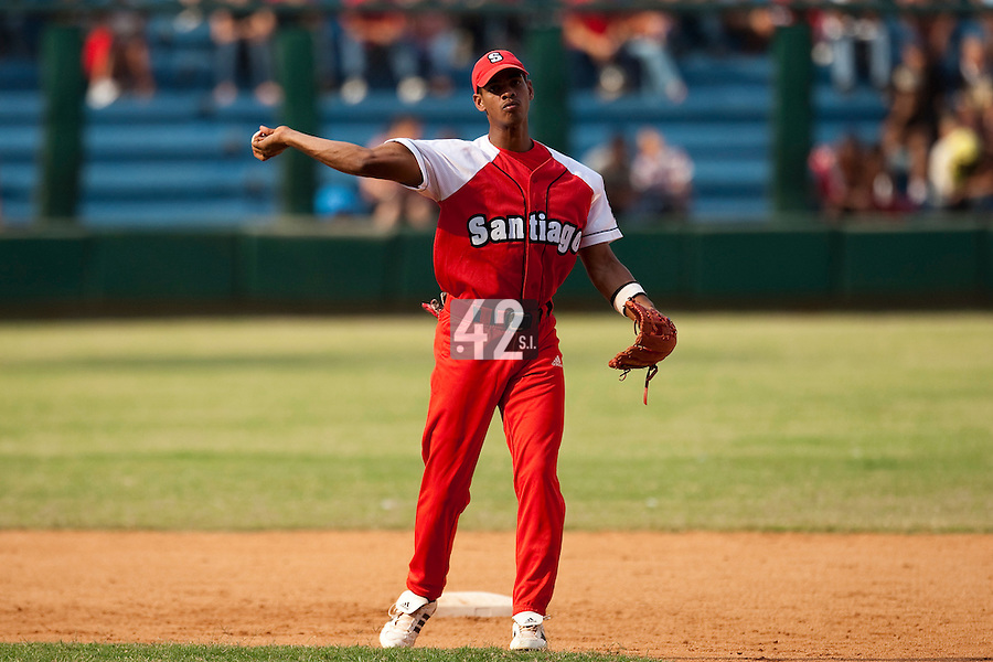 15 February 2009: Second base Hector Olivera of the Orientales throws the ball to first base during a training game of Cuba Baseball Team for the World Baseball Classic 2009. The national team is pitted against itself, divided in two teams called the Occidentales and the Orientales. The Orientales win 12-8, at the Latinoamericano stadium, in la Habana, Cuba.