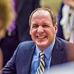4 February 2014: University of Vermont Catamount Head Coach John Becker smiles with players during a time out against the University of Maine Black Bears at Patrick Gymnasium in Burlington, Vermont. The Cats defeated the Bears 93-65 improving to 9-1 in America East and 15-9 overall. Mandatory Credit: Ed Wolfstein Photo *** RAW (NEF) Image File Available ***