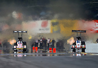 Oct. 6, 2012; Mohnton, PA, USA: NHRA top fuel dragster driver David Grubnic (right) races alongside teammate Doug Kalitta during qualifying for the Auto Plus Nationals at Maple Grove Raceway. THis run would mark the quickest side by side race in NHRA history. Mandatory Credit: Mark J. Rebilas-