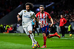 Marcelo Vieira Da Silva (l) of Real Madrid battles for the ball with Saul Niguez Esclapez of Atletico de Madrid during the La Liga 2017-18 match between Atletico de Madrid and Real Madrid at Wanda Metropolitano  on November 18 2017 in Madrid, Spain. Photo by Diego Gonzalez / Power Sport Images