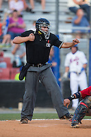 Home plate umpire Garon Keuten calls a batter out on strikes during the Appalachian League game between the Elizabethton Twins and the Kingsport Mets at Hunter Wright Stadium on July 9, 2015 in Kingsport, Tennessee.  The Twins defeated the Mets 9-7 in 11 innings. (Brian Westerholt/Four Seam Images)