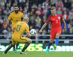Jack Wilshere of England drinks the ball past Aaron Mooy of Australia during the International Friendly match at the Stadium of Light, Sunderland. Photo credit should read: Simon Bellis/Sportimage