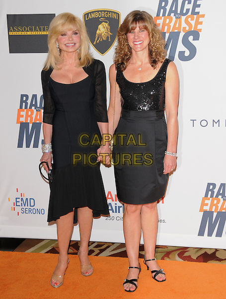LONI ANDERSON & DEIDRA HOFFMAN .at the 17th Annual Race to Erase MS held at The Hyatt Regency Century Plaza in Beverly Hills, California, USA, May 7th 2010..full length dress  black cleavage plastic surgery mother mum mom daughter family holding hands sequined sequin top skirt sleeveless .CAP/RKE/DVS.©DVS/RockinExposures/Capital Pictures.