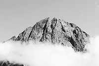Black and White Photo of a Mountain Top at Milford Sound, Fiordland, South Island, New Zealand. The mountains that tower up to 1500m on either side of Milford Sound are very impressive, especially if you are lucky enough to avoid one of the 180 days of rain a year!