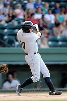 Left fielder Michael O'Neill (10) of the Charleston RiverDogs bats in a game against the Greenville Drive on Thursday, August 21, 2014, at Fluor Field at the West End in Greenville, South Carolina. Charleston won, 12-0. (Tom Priddy/Four Seam Images)