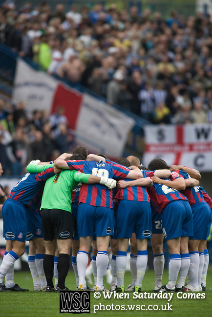 Crystal Palace players gathering in a huddle at Hillsborough prior to kick-off at the crucial last-day relegation match against Sheffield Wednesday. The match ended in a 2-2 draw which meant Wednesday were relegated to League 1. Crystal Palace remained in the Championship despite having been deducted 10 points for entering administration during the season.