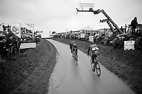 riders racing through a hague of protesting farmers <br /> <br /> 77th Gent-Wevelgem 2015