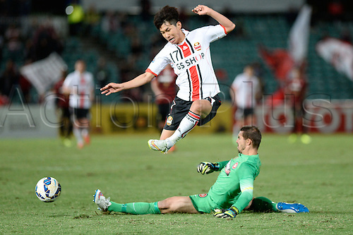 07.04.2015. Sydney, Australia. AFC Champions League. Western Sydney Wanderers v FC Seoul. Wanderers goalkeeper Ante Covic  slides in to win the ball from Seoul midfielder Yun Il-lok.