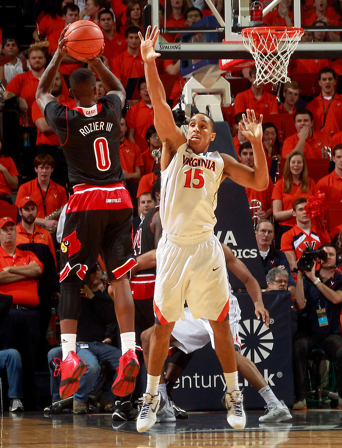 Louisville guard Terry Rozier (0) shoots over Virginia guard Malcolm Brogdon (15) during the second half of an NCAA basketball game Saturday Feb. 7, 2015, in Charlottesville, Va. Virginia defeated Louisville  52-47. (Photo/Andrew Shurtleff)