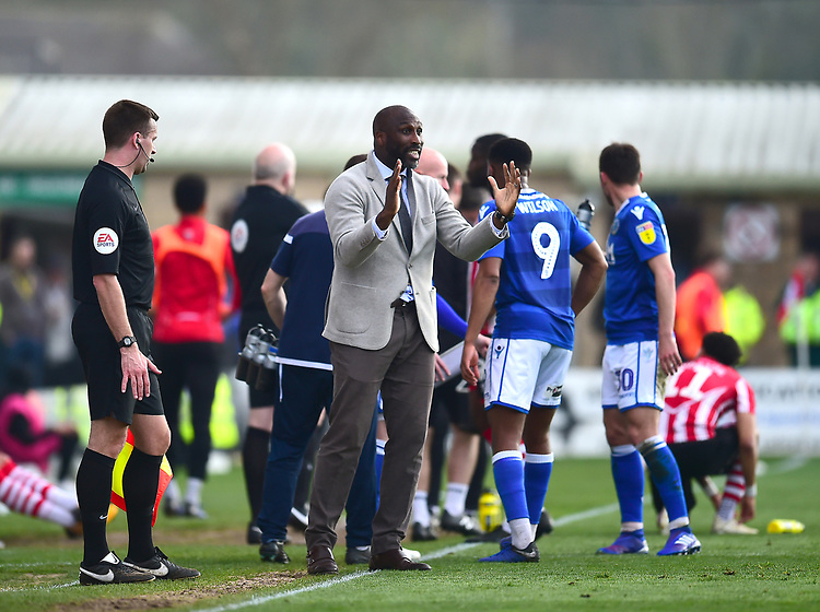 Macclesfield Town manager Sol Campbell shouts instructions to his team from the technical area during a break in play<br /> <br /> Photographer Andrew Vaughan/CameraSport<br /> <br /> The EFL Sky Bet League Two - Lincoln City v Macclesfield Town - Saturday 30th March 2019 - Sincil Bank - Lincoln<br /> <br /> World Copyright © 2019 CameraSport. All rights reserved. 43 Linden Ave. Countesthorpe. Leicester. England. LE8 5PG - Tel: +44 (0) 116 277 4147 - admin@camerasport.com - www.camerasport.com
