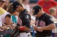 Paulo Orlando (18) and Micah Schnurstein (50) sign autographs for fans at Ernie Shore Field in Winston-Salem, NC, Wednesday, August 15, 2007.
