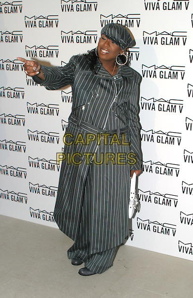 MISSY ELLIOTT.MAC Make-Up Viva Glam V Launch, The Hempel Hotel, Craven Hill Gardens.18 February 2004.full length, full-length, long pinstripe coat, hat, posing, funny, pointing.www.capitalpictures.com.sales@capitalpictures.com.© Capital Pictures.