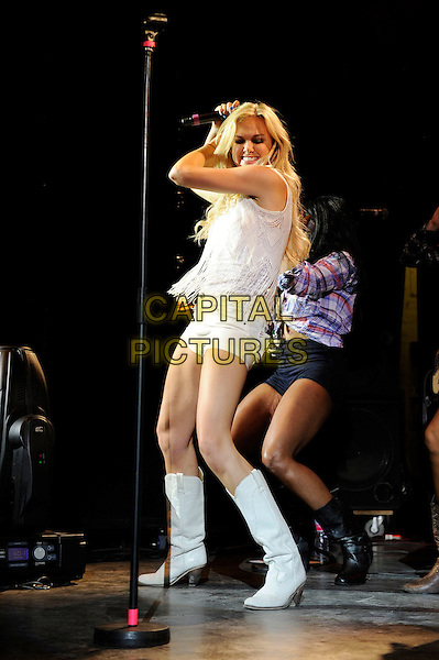 Laura Bell Bundy <br /> performing in concert, Shepherd's Bush Empire, London, England, UK, 11th July 2013.<br /> Music concert gig live on stage full length white shirts sleeveless top microphone fringed tassels <br /> CAP/MAR<br /> &copy; Martin Harris/Capital Pictures
