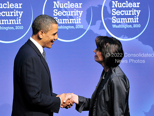 United States President Barack Obama welcomes Doris Leuthard,.President of the Swiss Confederation to  the Nuclear Security Summit at the Washington Convention Center, Monday, April 12, 2010 in Washington, DC. .Credit: Ron Sachs / Pool via CNP