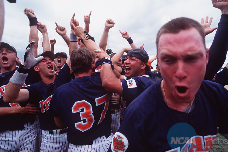 Caption: The California State Fullerton Titans scream and yell in celebration following their 11-5 victory over the University of Southern California at the College World Series June 10, 1995 in Omaha, Nebraska. Rich Clarkson/NCAA photos.