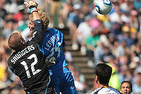 San Jose Earthquakes forward Steven Lenhart (24) goes up for the header against Los Angeles Galaxy goalkeeper Josh Saunders (12). The San Jose Earthquakes tied the Los Angeles Galaxy 0-0 at Buck Shaw Stadium in Santa Clara, California on June 25th, 2011.