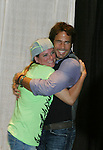 "Fans pose with Days Our Lives Shawn Christian ""Daniel"" who highlights the 10th Annual Connecticut Women's Expo on September 23, 2012 in Hartford, Connecticut and also on Sunday Sept 24 where he signed for fans and posed for photos.  (Photo by Sue Coflin/Max Photos)"