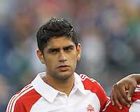 Toronto FC midfielder Matias Laba (20). In a Major League Soccer (MLS) match, Toronto FC (white/red) defeated the New England Revolution (blue), 1-0, at Gillette Stadium on August 4, 2013.