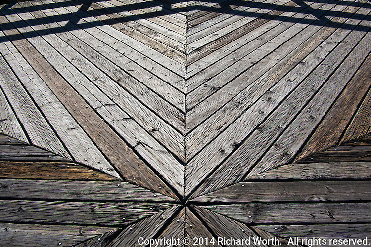 An observation deck presents lines and angles, all pointing to a single central point.