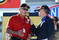 Oct. 28, 2012; Las Vegas, NV, USA: NHRA announcer Bob Frey interviews Toyota executive Keith Dahl during the Big O Tires Nationals at The Strip in Las Vegas. Mandatory Credit: Mark J. Rebilas-