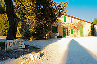 A painted sign with an arrow pointing to the winery and the building  at Mas de Gourgonnier, in Les Baux de Provence, Bouches du Rhone, France