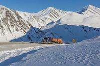 Industrial trucker travels the James Dalton Highway through Atigun Pass, Brooks Range, Alaska.