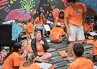 Members of the O-Team get a brief break in the Bengal Room, their base, during Orientation, Aug. 25, 2016. The team actively moves Orientation forward for Occidental College students with the class of 2020.<br /> (Photo by Marc Campos, Occidental College Photographer)