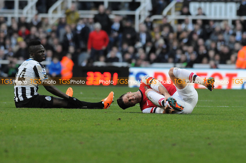 Olivier Giroud of Arsenal goes down injured after clashing with Cheik Tioté of Newcastle United - Newcastle United vs Arsenal - Barclays Premier League Football at St James Park, Newcastle upon Tyne - 29/12/13 - MANDATORY CREDIT: Steven White/TGSPHOTO - Self billing applies where appropriate - 0845 094 6026 - contact@tgsphoto.co.uk - NO UNPAID USE