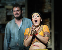 London, UK. 13.06.2014. Penny Woolcock's THE PEARL FISHERS returns to ENO, at the London Coliseum, as a co-production with the Metropolitan Opera, New York. Picture shows: George von Bergen (Zurga) and Sophie Bevan (Leila). Photograph © Jane Hobson.