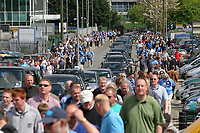 Fans walk towards the ground alongside the cars trying to enter the Stadium. Wycombe Wanderers FC have just one  road as a means of entry and exit into their ground during Wycombe Wanderers vs Notts County, Coca Cola League Division Two Football at Adams Park on 2nd May 2009