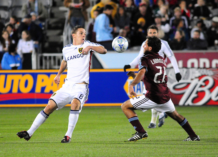 25 October 08: Rapids midfielder Nick LaBrocca looks to control the ball against Real Salt Lake midfielder Will Johnson (in white). Real Salt Lake tied the Colorado Rapids 1-1 at Dick's Sporting Goods Park in Commerce City, Colorado. The tie advanced Real Salt Lake to the playoffs.