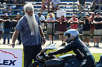 Sept. 22, 2012; Ennis, TX, USA: NHRA crew member for pro stock motorcycle rider Matt Guidera during qualifying for the Fall Nationals at the Texas Motorplex. Mandatory Credit: Mark J. Rebilas-