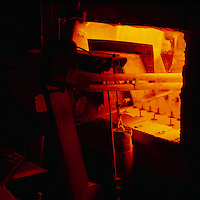 Sand is put into furnace where it is turned into glass and then bottles after being boiled and cooled, Leeds, England.
