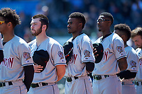Wisconsin Timber Rattlers David Fry (10), Korry Howell (36), and Je'Von Ward (4) during the National Anthem before a Midwest League game against the Great Lakes Loons at Dow Diamond on May 4, 2019 in Midland, Michigan. Great Lakes defeated Wisconsin 5-1. (Zachary Lucy/Four Seam Images)