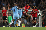 Vincent Kompany of Manchester City and Marcus Rashford of Manchester United during the English Premier League match at The Etihad Stadium, Manchester. Picture date: April 27th, 2016. Photo credit should read: Lynne Cameron/Sportimage