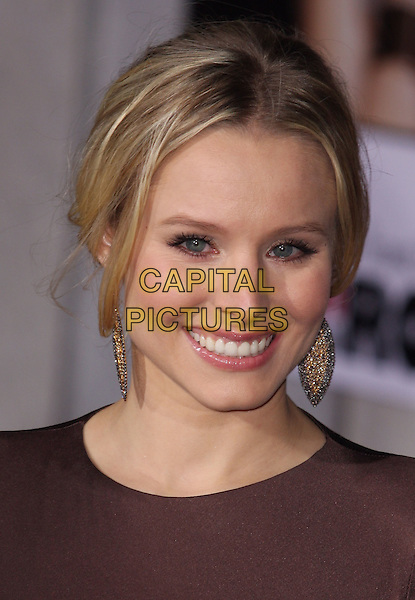 "KRISTEN BELL .""When In Rome"" Los Angeles Premiere - Arrivals held at The El Capitan Theater, Hollywood, CA, USA, .27th January 2010..portrait headshot hair up earrings dangly gold  brown smiling .CAP/ADM/CH.©Charles Harris/AdMedia/Capital Pictures"