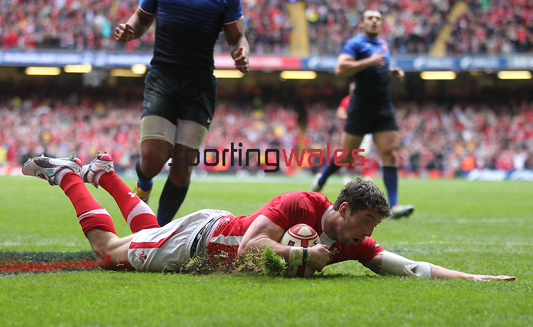 Alex Cuthbert dives over to score the first try of the match for Wales..RBS 6 Nations 2012.Wales v France.Millennium Stadium.17.03.12..CREDIT: STEVE POPE-SPORTINGWALES