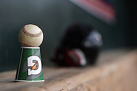 A baseball sits on top of a Gatorade cup in the New Britain Rock Cats dugout during practice before a game against the Harrisburg Senators on April 28, 2014 at Metro Bank Park in Harrisburg, Pennsylvania.  Harrisburg defeated New Britain 9-0.  (Mike Janes/Four Seam Images)