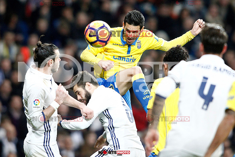 Real Madrid's Gareth Bale (l) and Nacho Fernandez (c) and UD Las Palmas' Vicente Gomez during La Liga match. March 1,2017. (ALTERPHOTOS/Acero) /NortePhoto.com